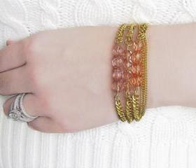 Bead Bracelet Stack in Transparent Shades of Pink on Gold Chain